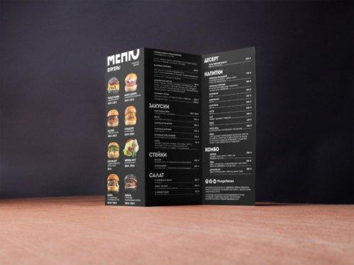 "Двустороннее меню с 2-мя сгибами для ""Бургер Хироуз"". Формат - 99х210 мм.Мелованная бумага, двусторонняя матовая ламинация, биговка"